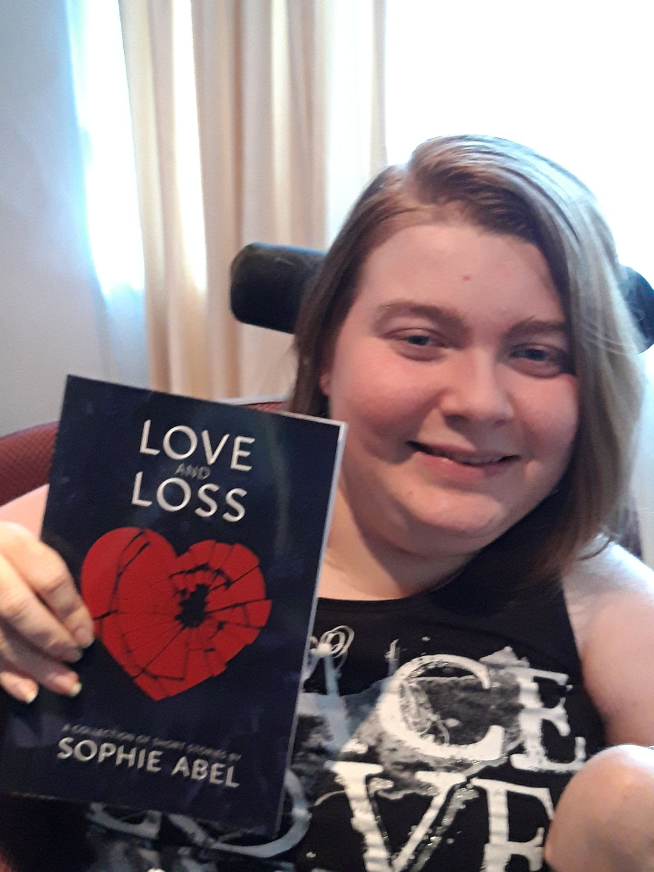 love and loss giveaway: author with book